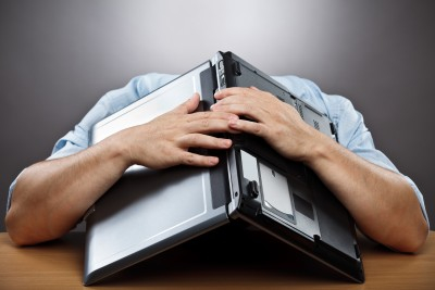 man with laptop over his head